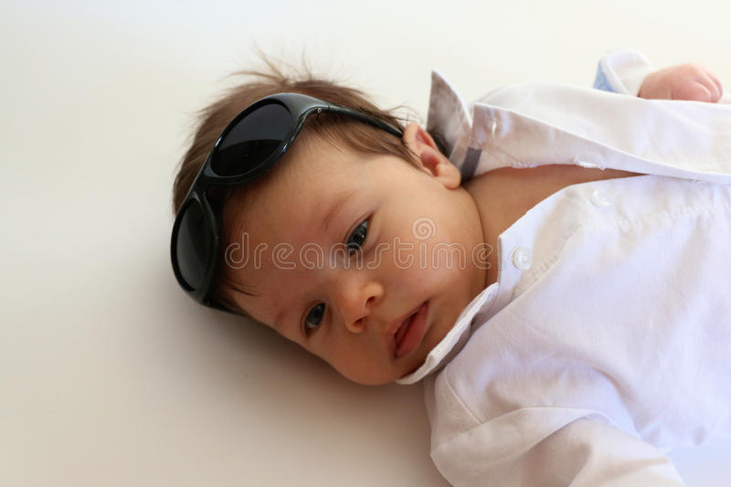 Baby Boy With Sunglasses. Baby boy with collared white shirt and sunglasses stock images