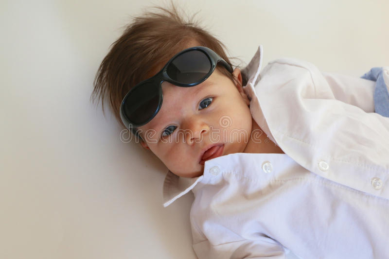 Baby Boy With Sunglasses. Baby boy with collared white shirt and sunglasses royalty free stock photo