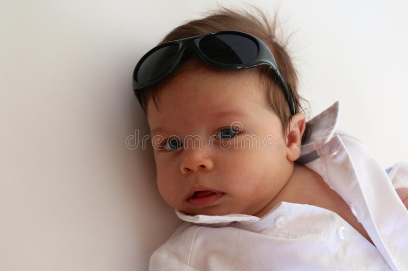 Baby Boy With Sunglasses. Baby boy with collared white shirt and sunglasses stock photo