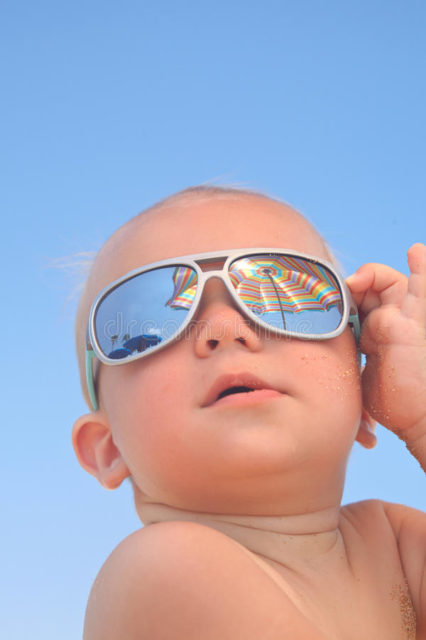 Baby boy with sunglasses. Portrait of adorable baby boy with sunglasses stock photo