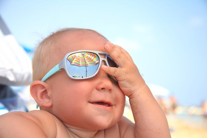 Baby boy with sunglasses. Portrait of adorable baby boy with sunglasses royalty free stock image