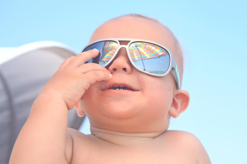 Baby boy with sunglasses. Portrait of adorable baby boy with sunglasses stock photography