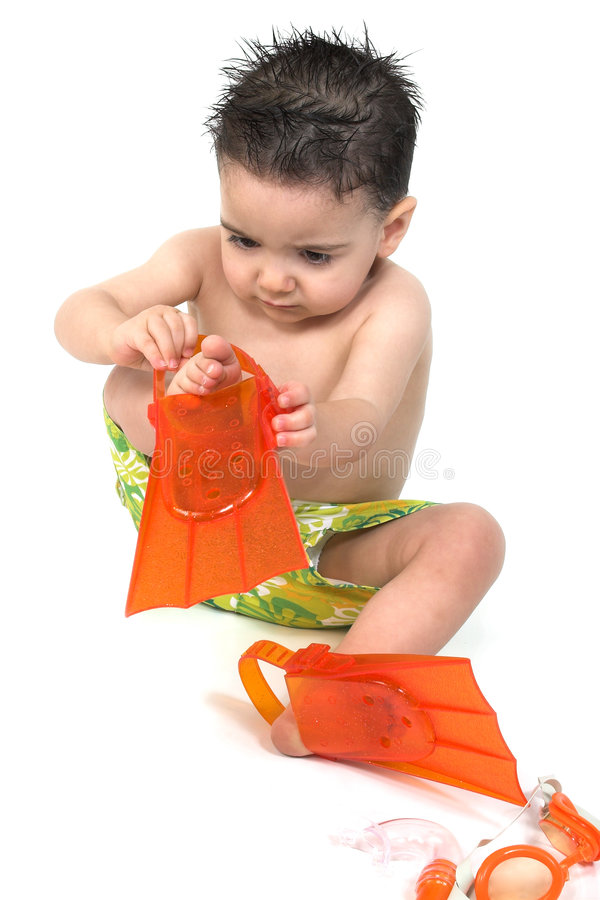 Baby Boy In Swimsuit And Flippers royalty free stock images