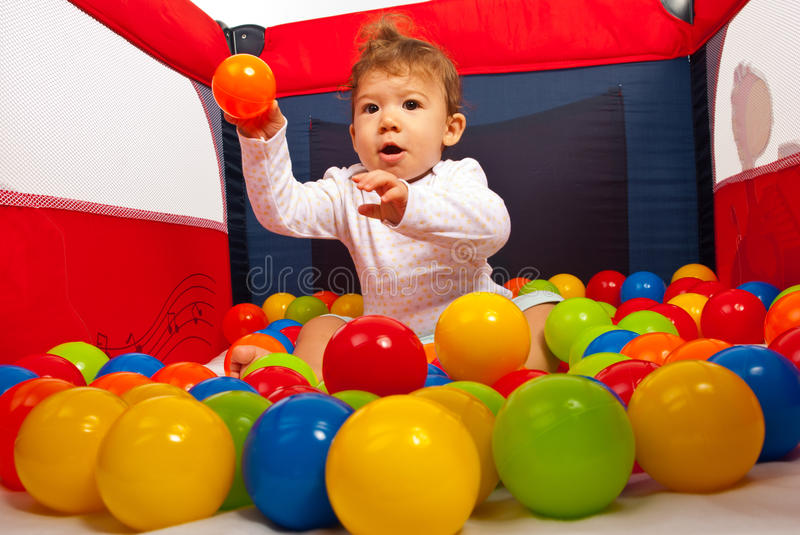 Baby boy throw the ball royalty free stock image