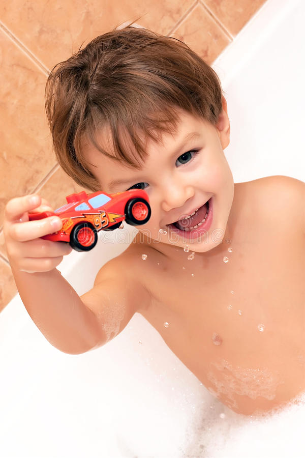 Free Baby Boy Toying In Bathroom Stock Images - 13593794