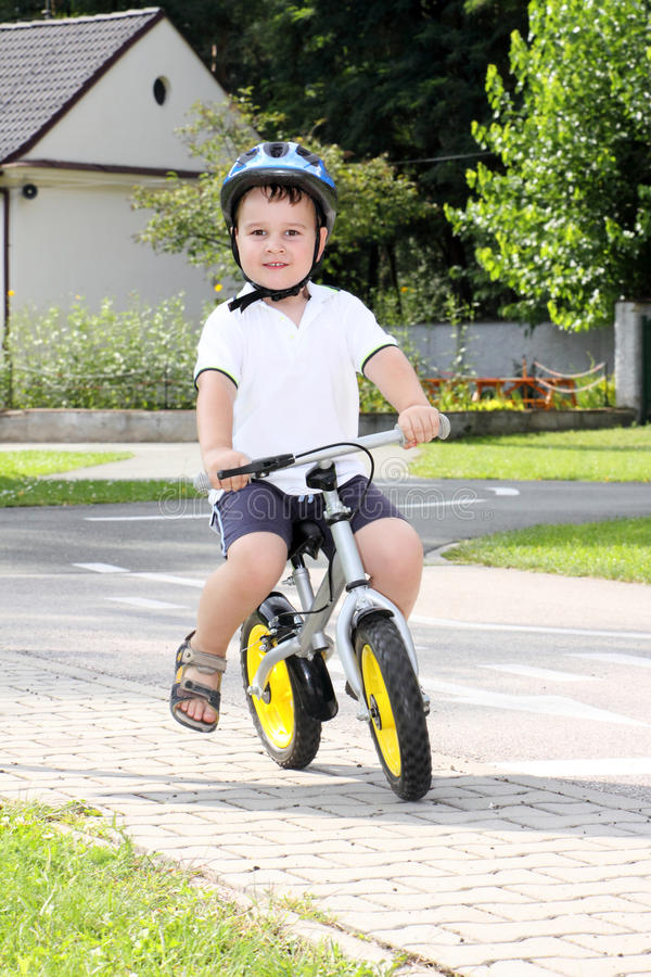 Child on bicycle royalty free stock images