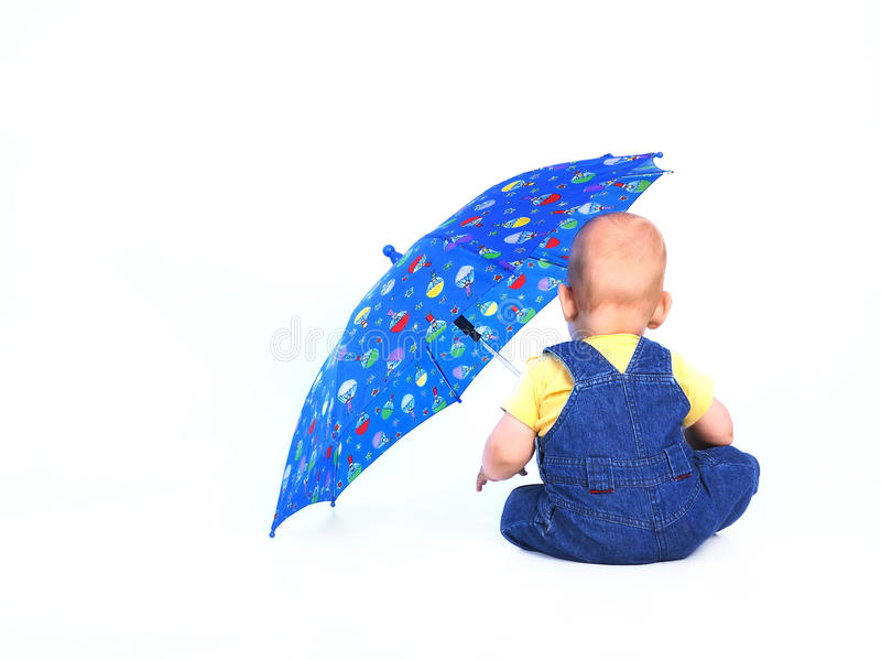 Baby boy with an umbrella royalty free stock photo