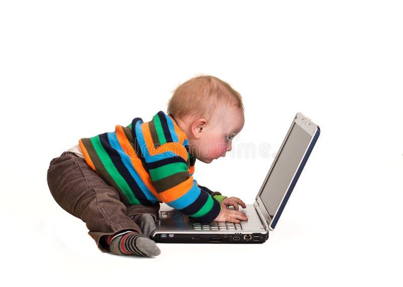 Baby boy using laptop royalty free stock photo
