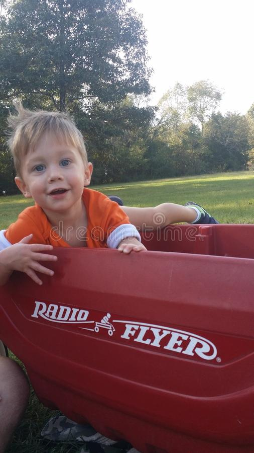 Baby boy in wagon stock images