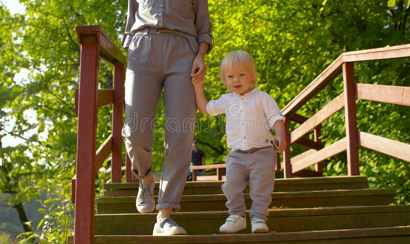 Baby boy walking on the bridge in the park royalty free stock image