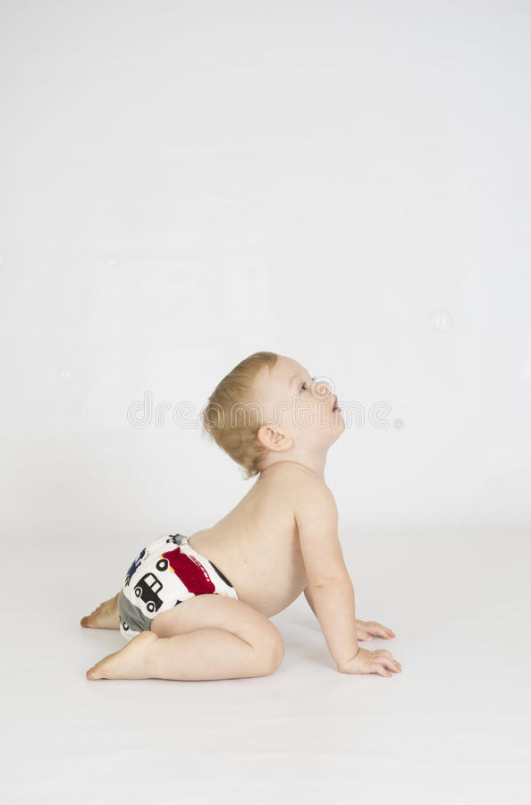 Baby boy wearing cloth reusable nappy stock photography