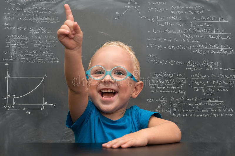 Baby boy wearing glasses with a clever look. stock images