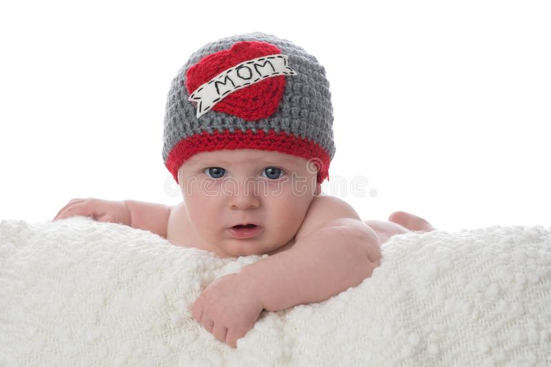 Baby Boy Wearing a Love Mom Hat royalty free stock images