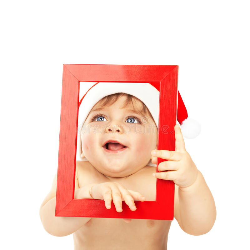 Baby boy wearing Santa Claus hat stock images