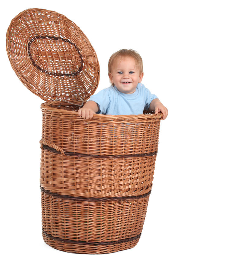Baby boy in wicker box. Baby boy in great wicker container with cover royalty free stock photography