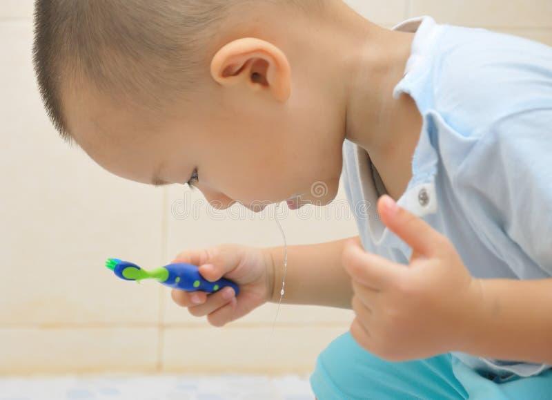 Baby brush teeth stock photos