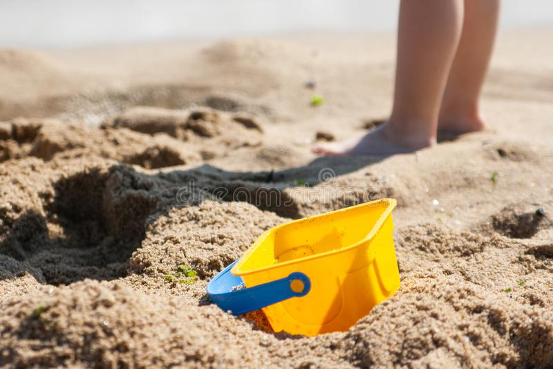 Baby bucket on a sandy beach in the background royalty free stock image