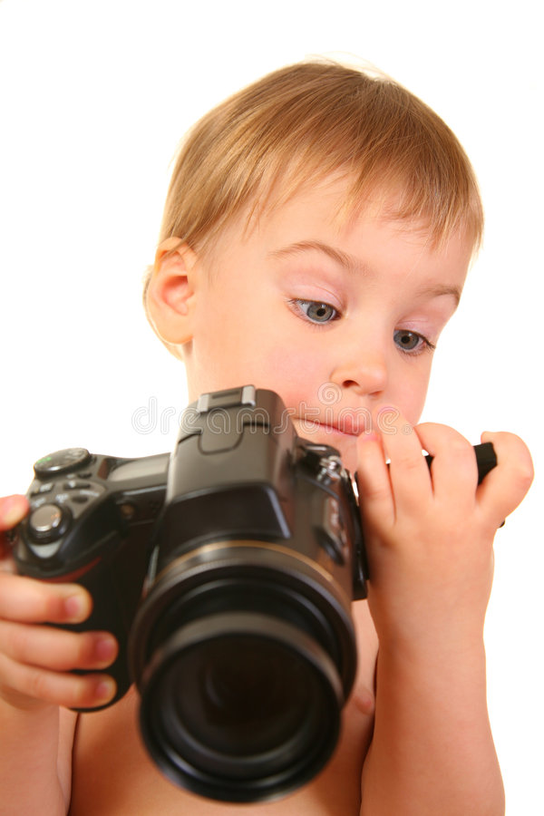 Baby with camera royalty free stock photography