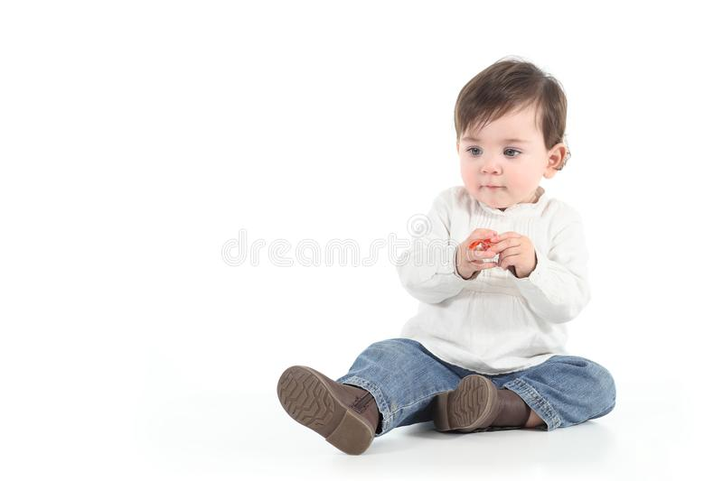 Download Baby With A Candy In Her Hands Stock Image - Image: 28836237