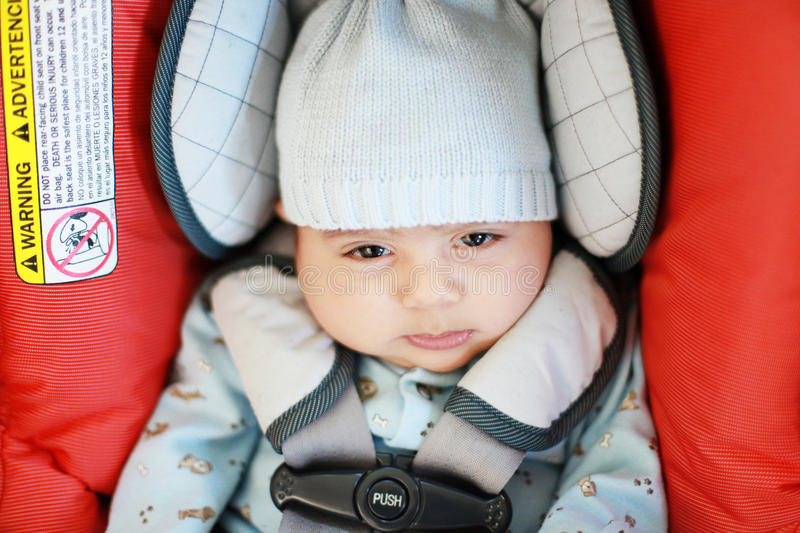 Baby in a car seat stock photography