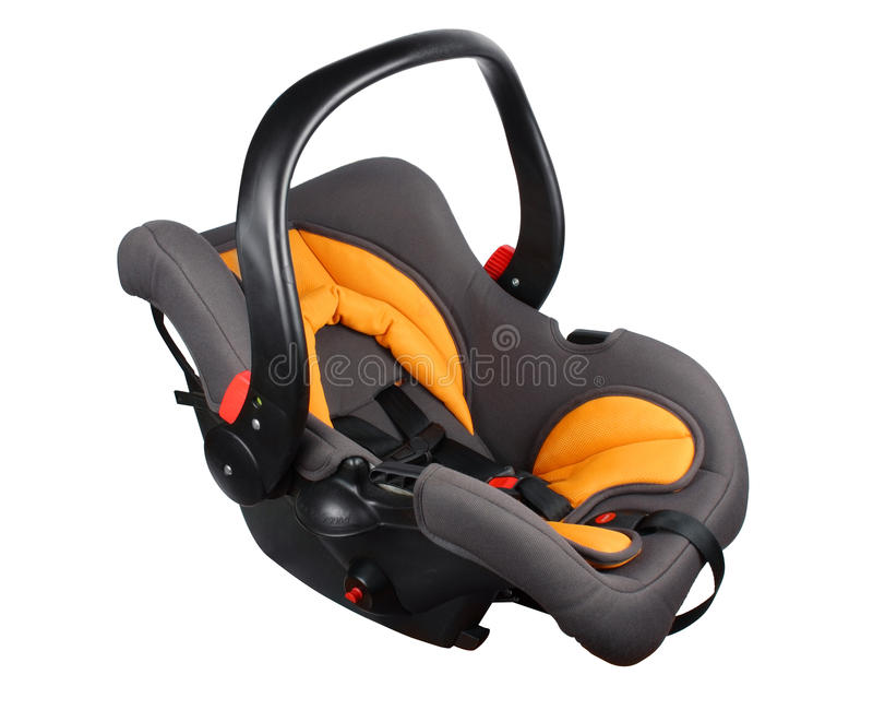 Baby car seat. Baby black and orange car seat isolated against a white background royalty free stock image