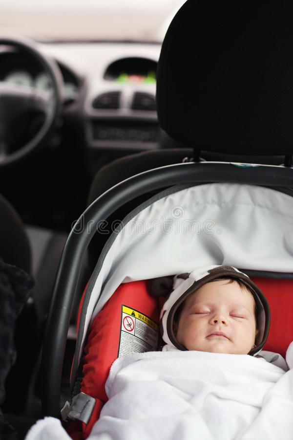 Baby car seat. A baby sleeping in a special car seat stock image