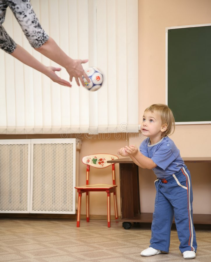 Baby catch ball stock photography