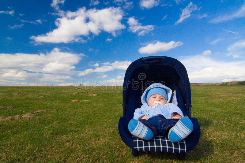 Baby On Chair Royalty Free Stock Photography