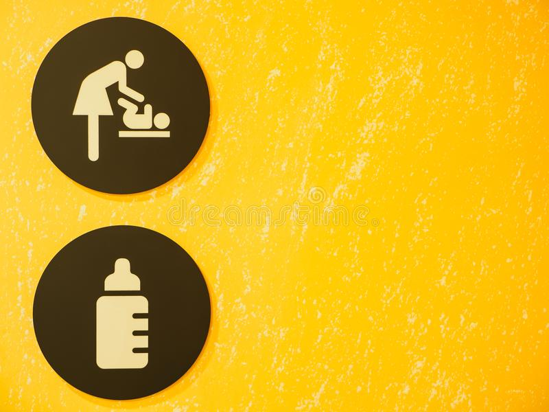 Baby Changing Room Sign and Symbol with yellow background. royalty free stock image
