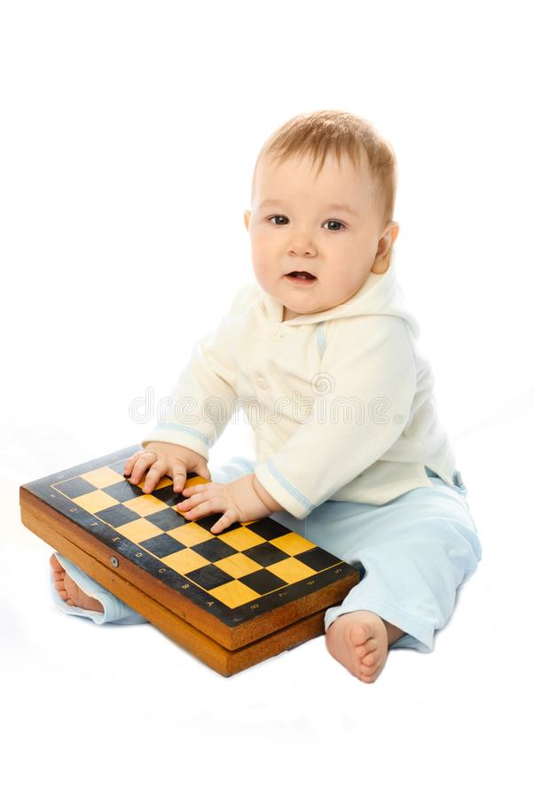 Download Baby with a chessboard stock image. Image of smart, adorable - 8344257