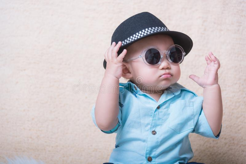 Baby child boy fashion. Sitting with sunglasses stock photos