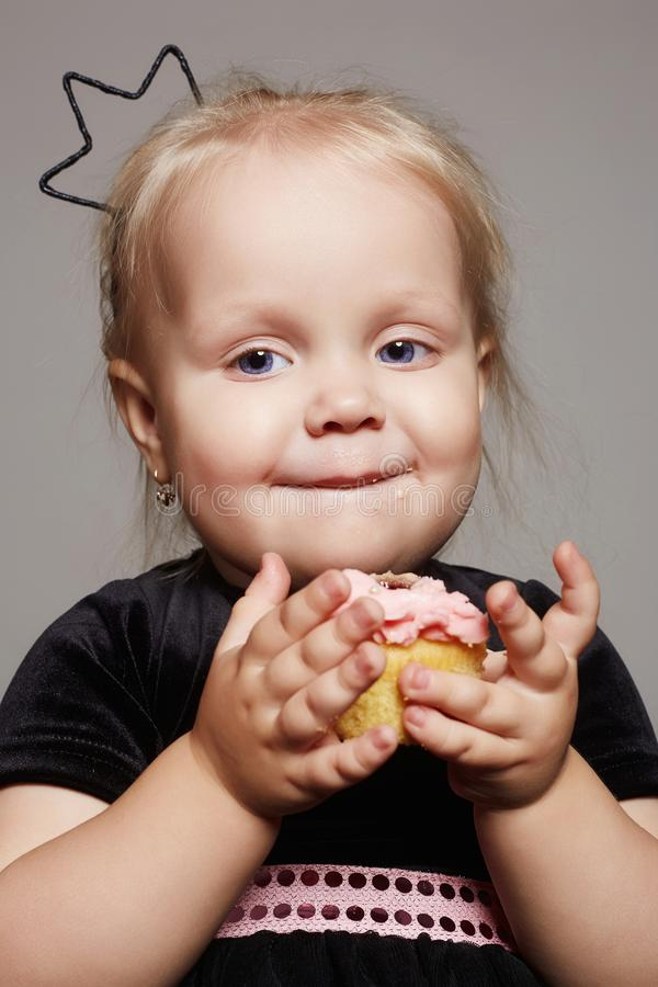 Baby child with a cake royalty free stock photography