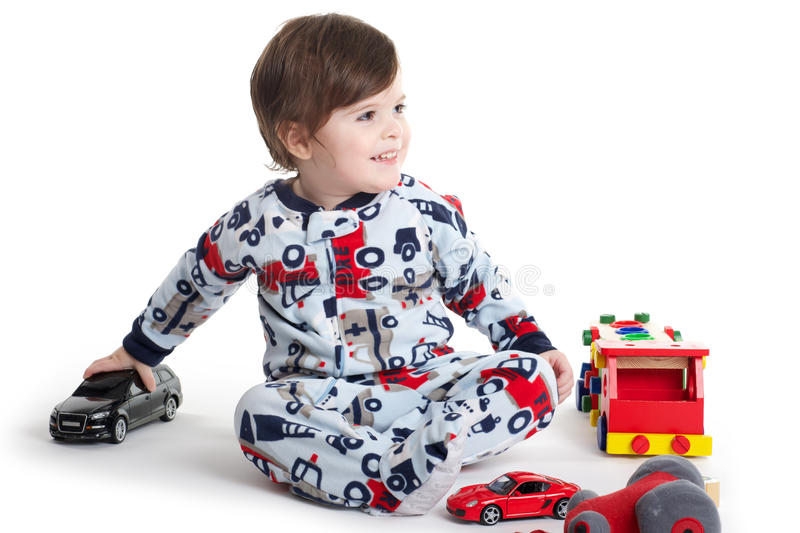 Baby Child playing. Baby toddler child playing with car toys stock image