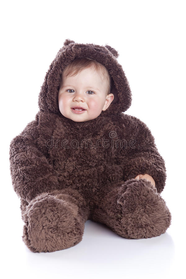 Baby child in teddy-bear costume. On white background stock image