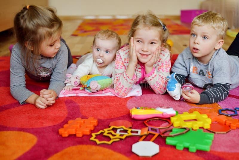 Baby and children   in kindergarten stock photos
