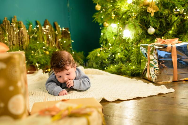 Baby and christmas concept. Baby with christmas background in winter season, baby healthy and winter concept. New Year`s holidays royalty free stock photography