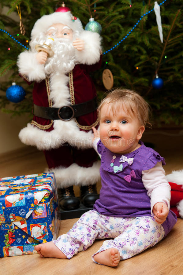 Baby with Christmas present stock photo