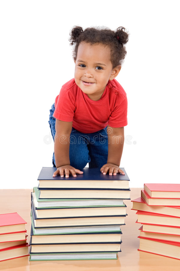 Baby climb up over a pile of books stock images