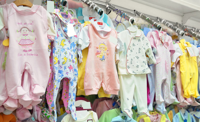 Baby clothes. Colorful modern baby clothes in a store royalty free stock photos