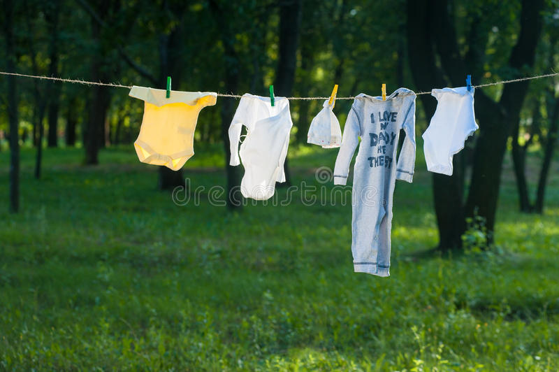 Baby Clothes dry on a rope outdoors. Freshness stock image