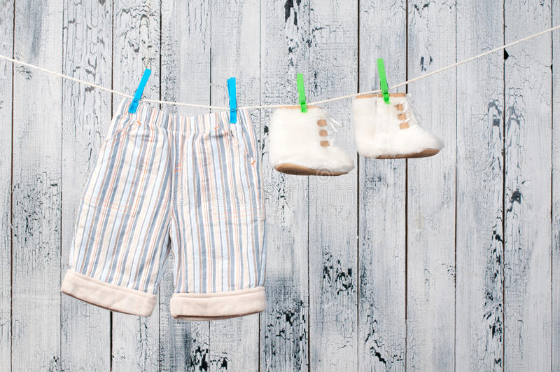 Baby clothes hanging on the clothesline. Baby clothes hanging on the clothesline royalty free stock image