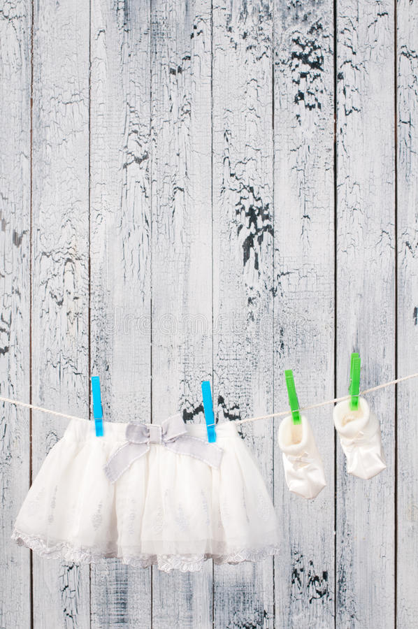 Baby clothes hanging on the clothesline. Baby clothes hanging on the clothesline royalty free stock photos