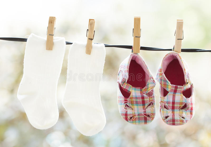 Baby clothes hanging. On the clothesline royalty free stock photography
