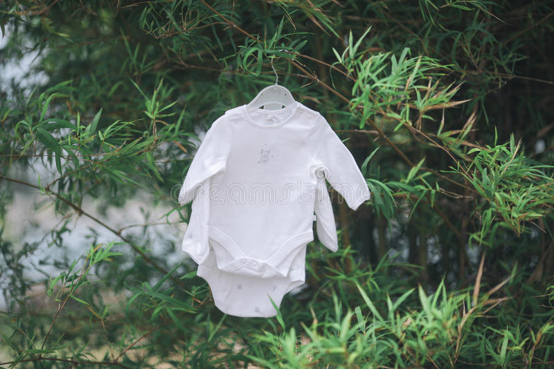 Baby clothes hanging on the clothesline. Baby clothes hanging on the clothesline stock images