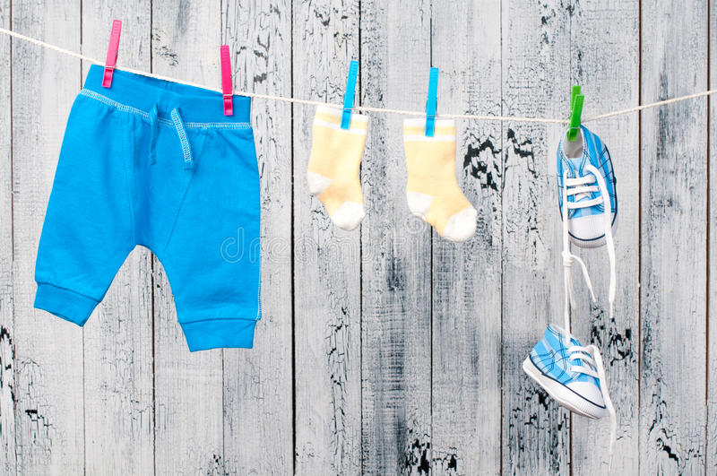 Baby clothes hanging on the clothesline. Child care stock photo