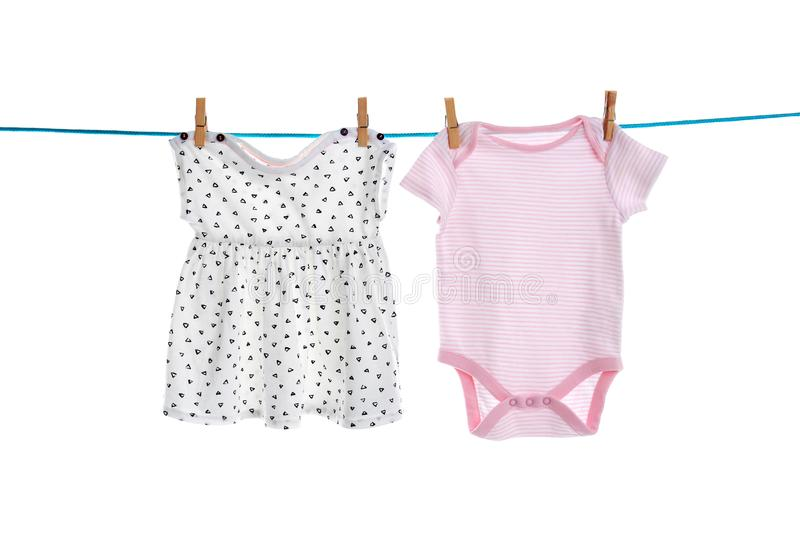Baby clothes on laundry line stock photos