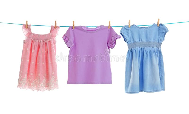 Baby clothes on laundry line. Against white background stock image