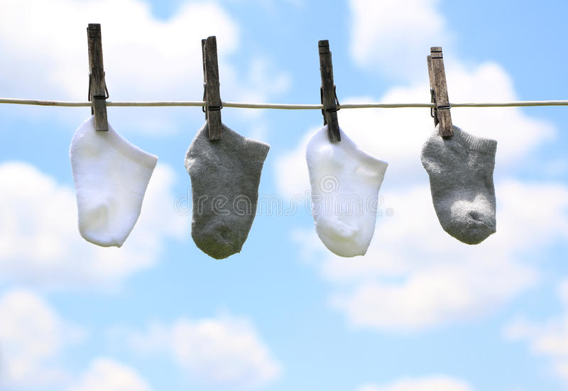 Baby Clothes on a Line stock photography