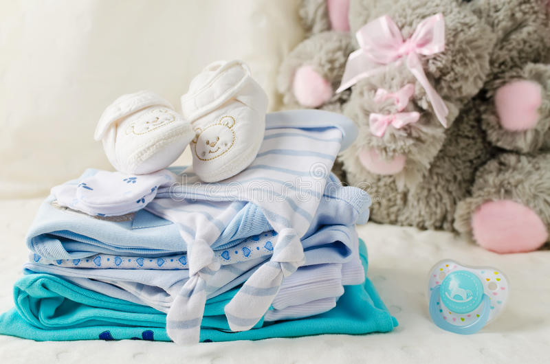 Baby clothes for newborn stock photos