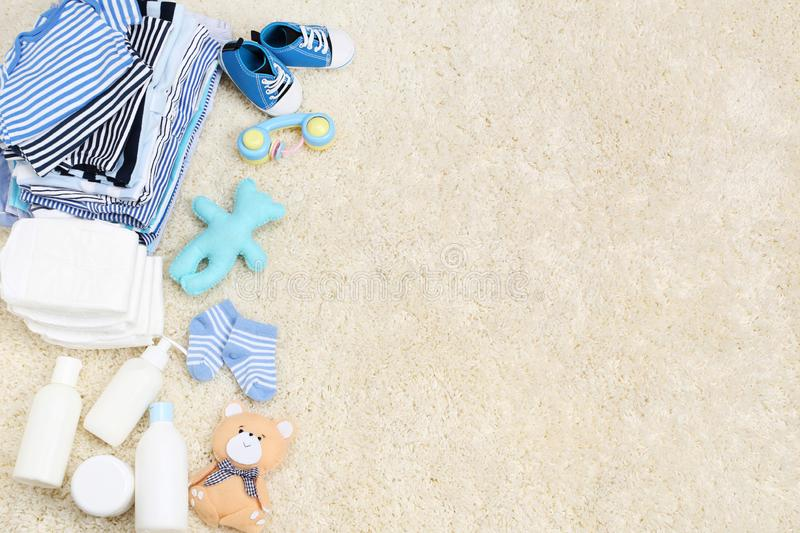 Baby clothes with toys royalty free stock photos